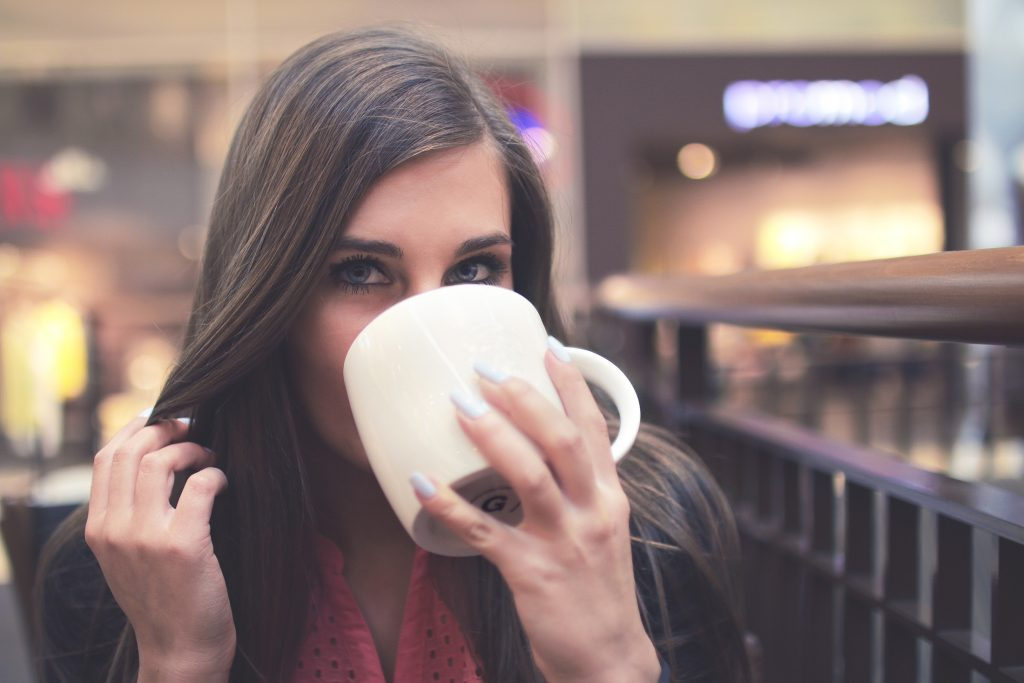woman drinking coffee - coffee lovers magazine